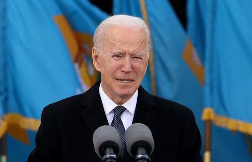 Biden Panics After CNN Reveals He Canceled COVID Origins Investigation Cropped_Joe_Biden_flags_via_Getty