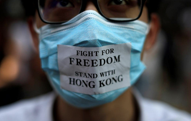 """""""You Can Really Feel People's Anger"""": Hong Kongers Gather To Protest Government's New Mask Ban"""